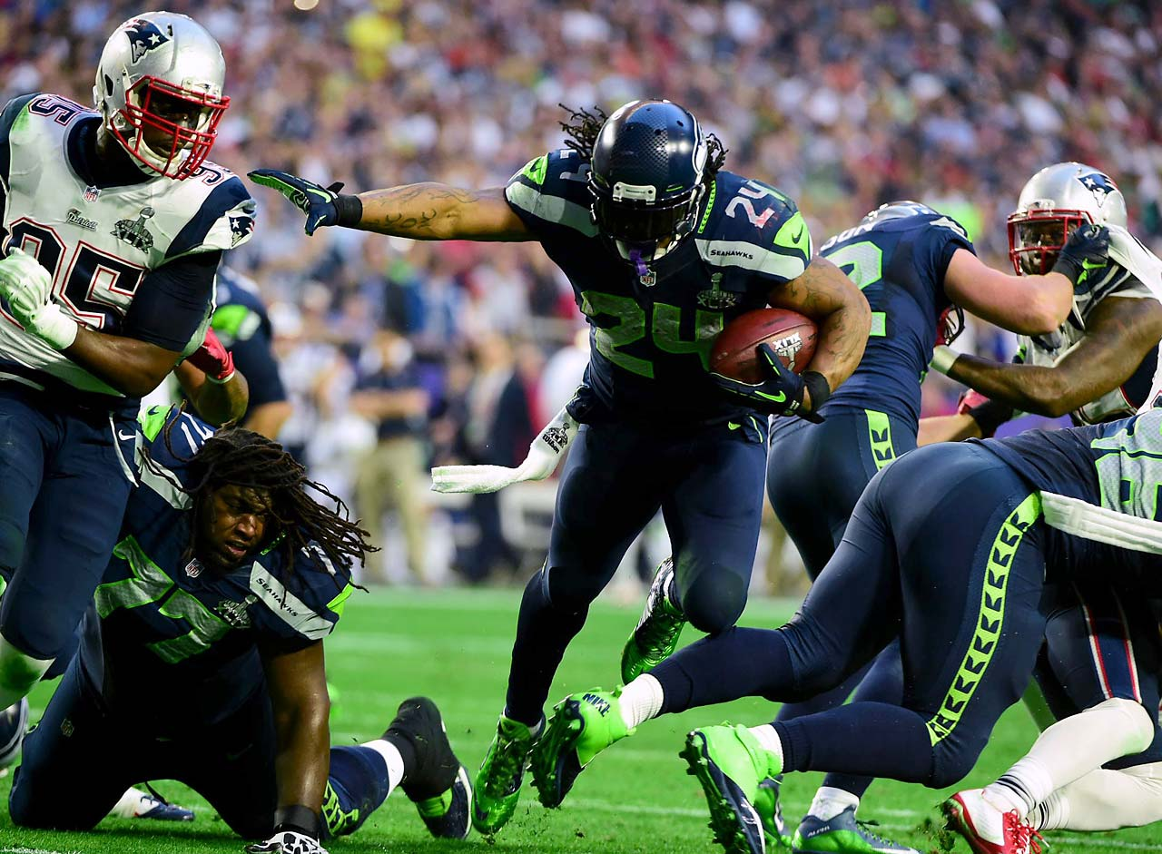 Marshawn Lynch rumbles for yardage against the Patriots.