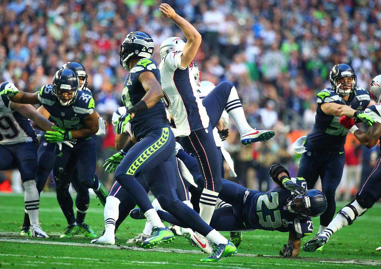 Ryan Allen gets toppled by a Seattle defender on an early punt.