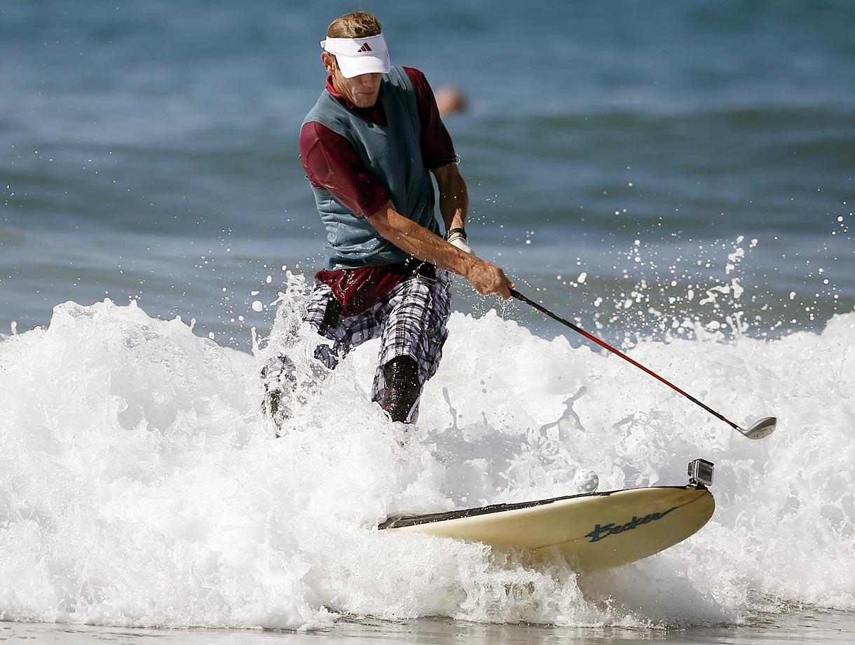 A surfer dressed as a golfer rides a wave during the 7th annual ZJ Boarding House Haunted Heats Halloween surf contest.