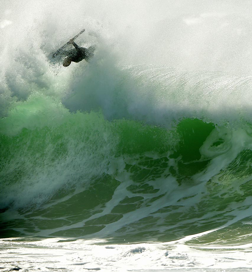A bodyboarding launches out of the shore pound at The Wedge.