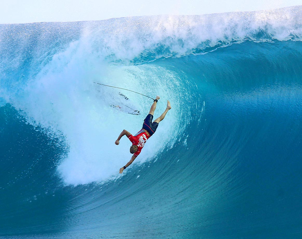 Mick Fanning of Australia takes a spill during the Billabong Pro Tahiti surf event on Sunday, August 24.