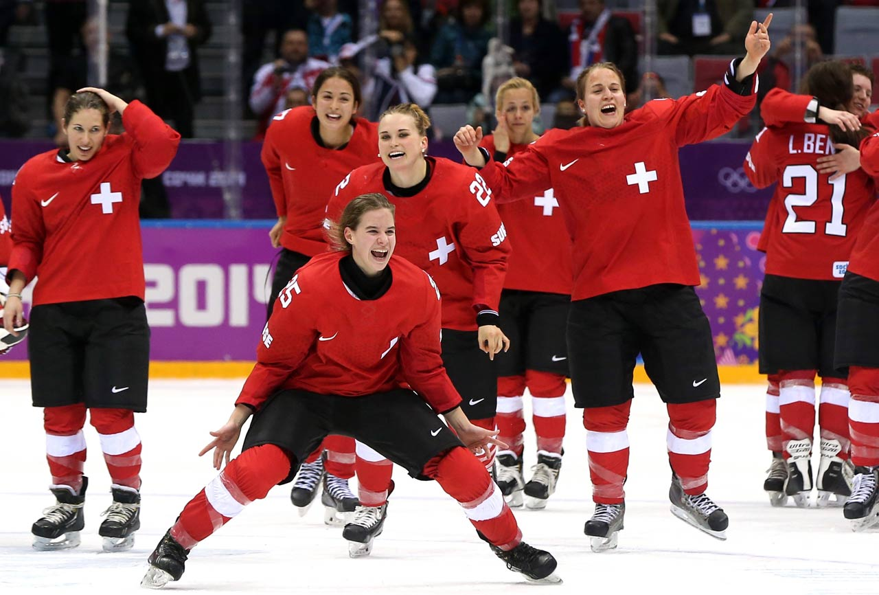 Alina Muller and teammates celebrate after defeating Sweden 4-3 during the bronze-medal game in women's hockey.