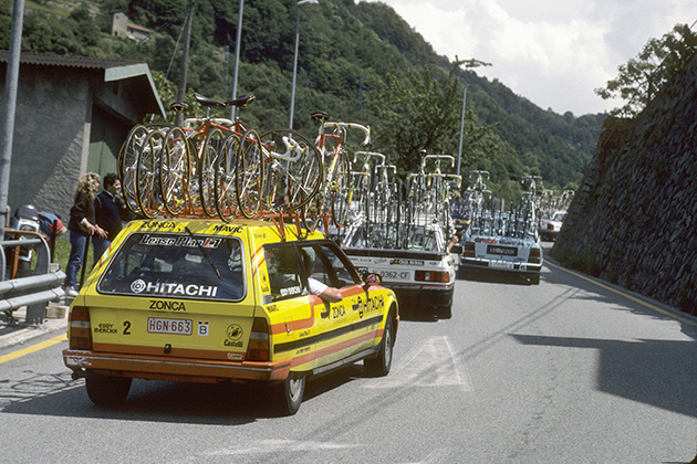 Support cars are shown during the 1989 Tour de France.