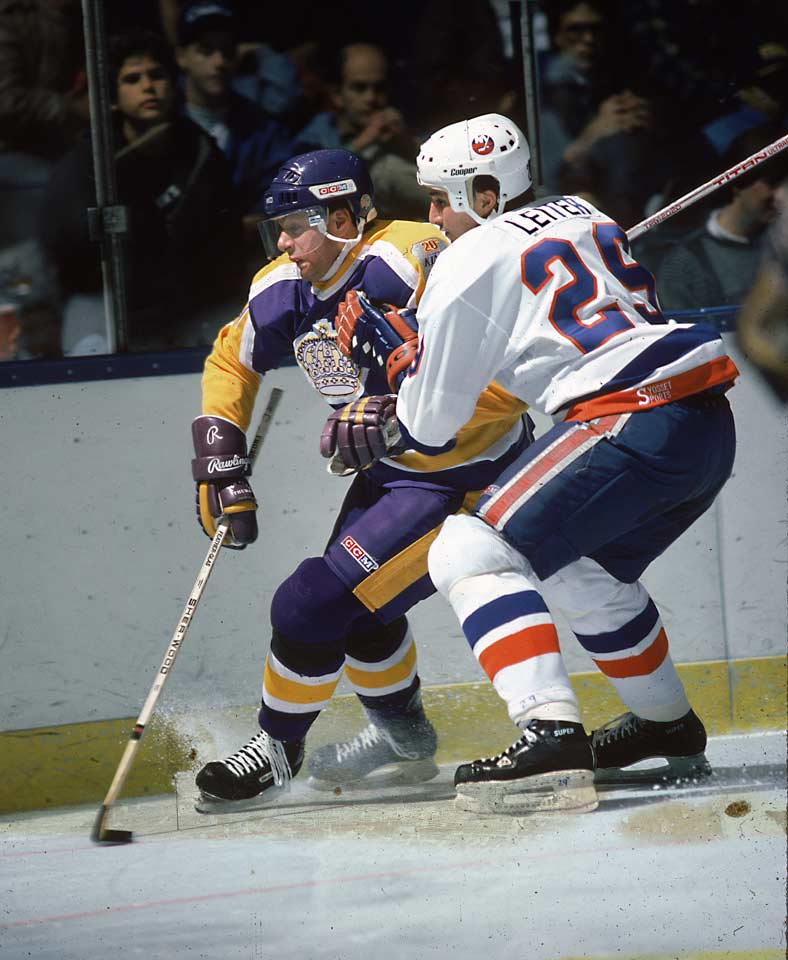 Remembered as the Kings' key player in their trade for Wayne Gretzky, Carson was the second pick in the '86 draft, after winger Joe Murphy (Detroit). A natural scorer with a mostly one-way game, Carson produced 39 goals and 79 points as a rookie, finishing behind teammate Luc Robitaille and Flyers goalie Ron Hextall in the Calder voting. At 19, he scored 55 goals and 107 points before being dealt. His career was brief, though, and he retired at 29.