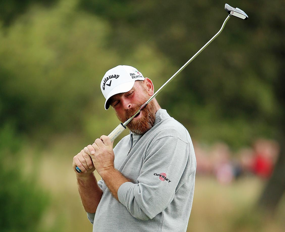 Thomas Bjorn of Denmark bites his putter after missing on the first hole during the Made In Denmark.