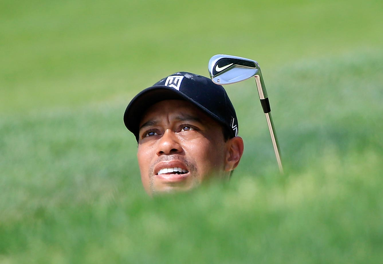Tiger Woods stares down his shot on the 17th hole during the last round of The Memorial Tournament in Dublin, Ohio, on June 7.