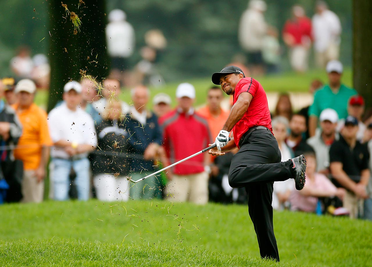 Tiger Woods hits out of the rough on the second hole during the final round of the World Golf Championships-Bridgestone Invitational at Firestone Country Club South Course on August 3, 2014 in Akron, Ohio.
