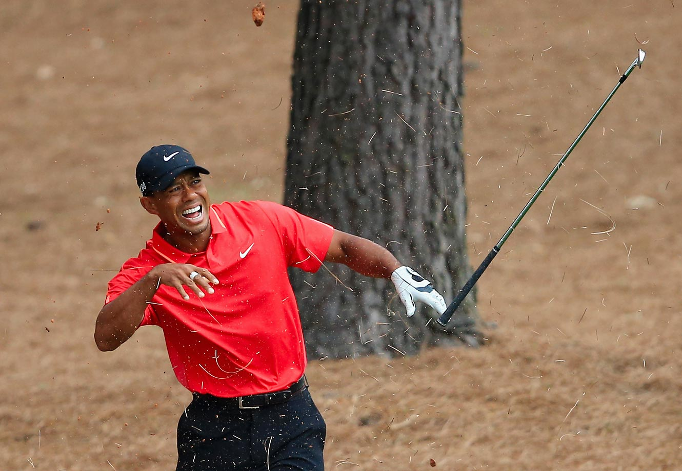 Tiger Woods winces in pain after making a shot on the ninth hole during the final round of the Masters. Tiger finished the tournament tied for 17th at five-under par.