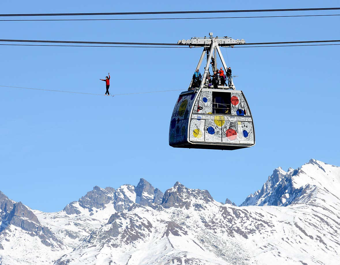 French highliner Julien Millot performs on the Paradiski cable way, 380m high, on Dec. 16, 2013, in front of the Mont Blanc mountain in La Plagne.