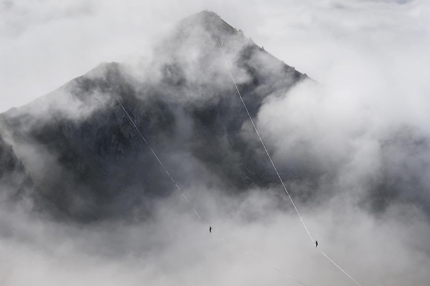 Two athetes compete in the fog during the Highline Extreme event.