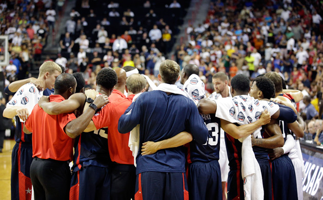Team USA players and coaches huddle after Indiana Pacers' Paul George was injured during the USA Basketball Showcase game Friday, Aug. 1, 2014, in Las Vegas.