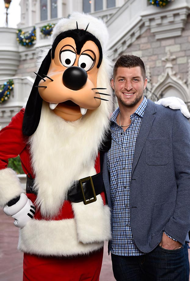 "Tim Tebow and Santa Goofy attend the taping of the Disney Parks ""Frozen Christmas Celebration"" TV Special in Magic Kingdom Park."