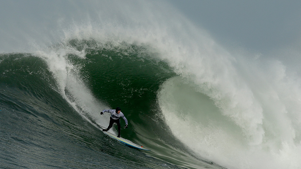 Surfers taking on Mavericks in Half Moon Bay, Calif.