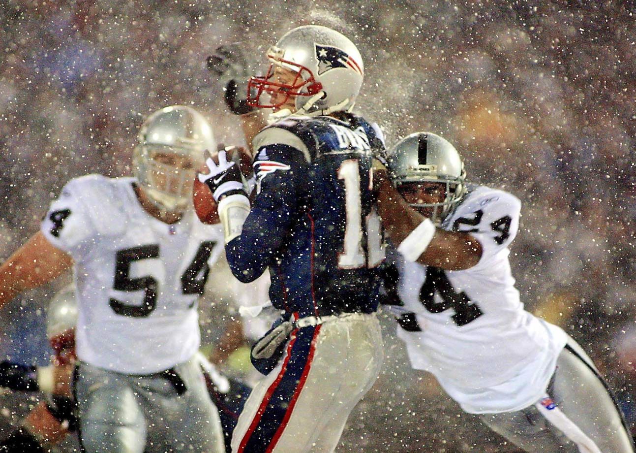 "Never has the distinction between ""attempting to tuck"" and ""has tucked"" been more controversial than in the AFC divisional playoff game between the Patriots and Raiders on Jan. 19, 2002. With the Patriots driving toward a game-tying field goal, cornerback Charles Woodson knocked the ball from Brady's hands, and linebacker Greg Biekert recovered it. The game-sealing fumble was overturned however, when upon review the referees ruled that Brady was still in the process of tucking the ball even though it had already made contact with his non-throwing, left hand. The Patriots won the game in overtime, while the Raiders fumed."