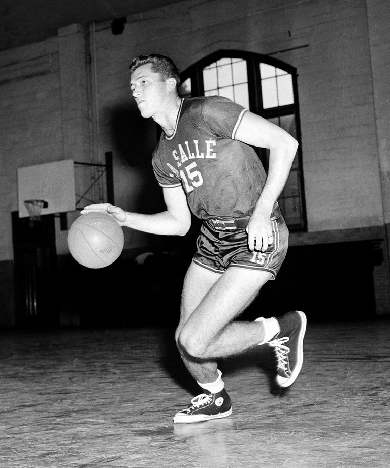 """A Philly boy whose decision to stay home paid off, Gola led the Explorers to two NCAA finals and the 1954 championship. The Helms Foundation Player of the Year in 1954, Gola holds the record for most career rebounds in NCAA history (2,201), and he is one of just two players to score more than 2,000 points and grab 2,000 boards. He scored 19 points in the 1954 championship game to help La Salle beat Bradley 92-76 and brought the Explorers back to the brink of a title in the 1955 tournament before falling to San Francisco. After La Salle beat Bradley to win the title, Yogi Berra called him """"the Joe DiMaggio of basketball"""" because of his composure."""