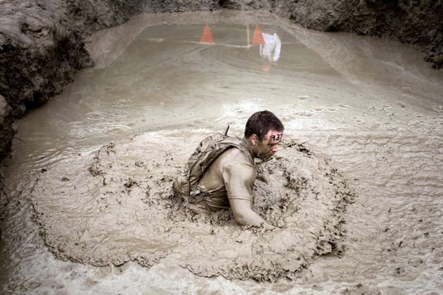 A competitor works his way through the mud mile during the Tough Mudder.