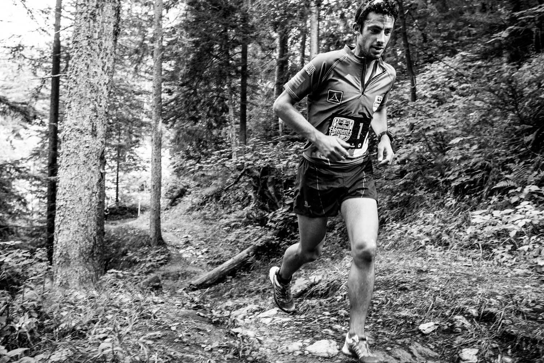 A runner treks through the rugged terrain for an adventure-style endurance race.