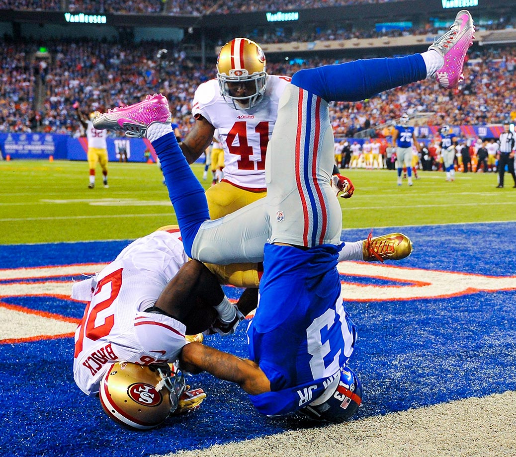 Tramaine Brock of the San Francisco 49ers catches an interception over Odell Beckham of the Giants.
