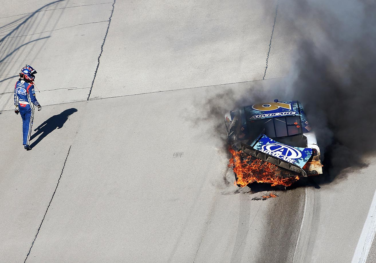 Trevor Bayne walks away from his car after crashing at Texas Motor Speedway.