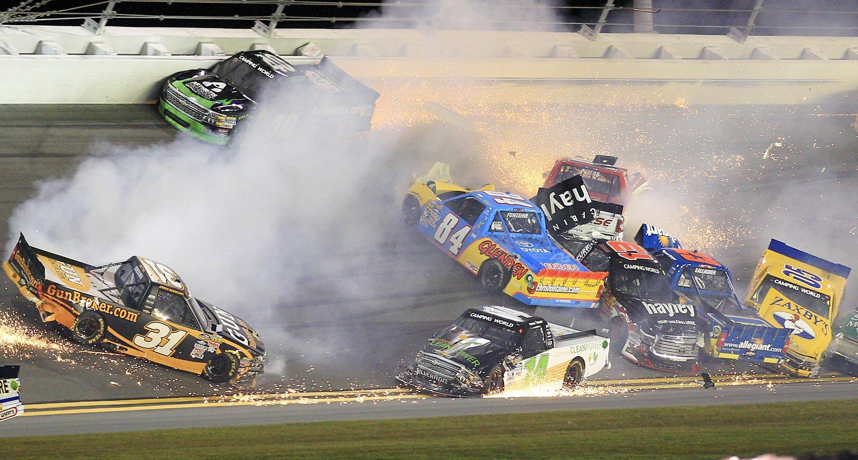 Drivers James Buescher (31), Todd Peck (40), Daniel Hemric (14), Chris Fontaine (84), Timothy Peters (17), Cameron Hayley (13), Spencer Gallagher (23), John Wes Townley (05), crash during the NASCAR Truck series race at Daytona International Speedway.