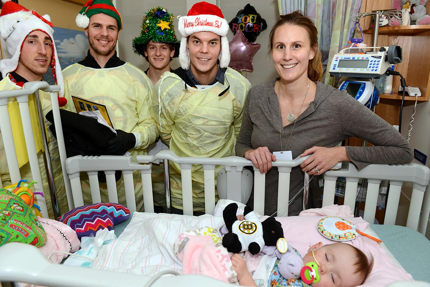 Brad Marchand, David Krejci, Tory Krug and Tukka Rask of the Boston Bruins visit the Boston Children's Hospital.