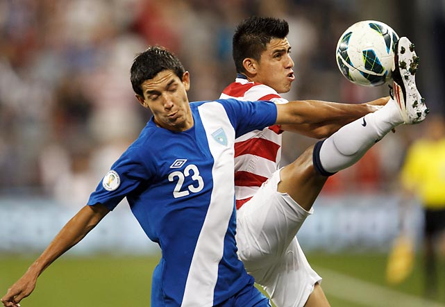 Guatemala defender Jonathan Lopez (23) and U.S. midfielder Joe Corona vie for the ball on Oct. 16, 2012, in Kansas City. The U.S. won 3-1 with two goals from Clint Dempsey and moved on to the CONCACAF Hexagonal -- the six-team, final round of qualifying.