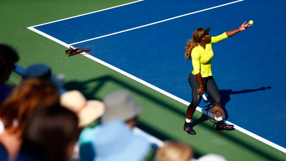 Fans watch Serena Williams practice ahead of the of the 2014 U.S. Open in New York.