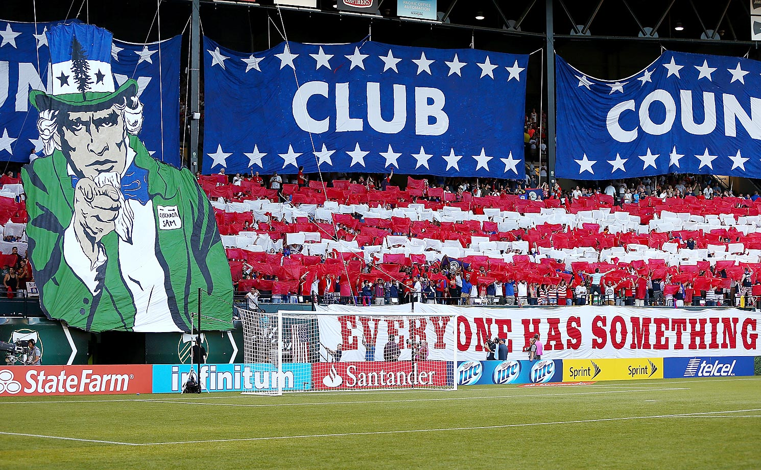 "Fans raise a tifo celebrating ""Community, Club and Country"" ahead of a CONCACAF Gold Cup match between the USA and Belize in Portland, Oregon."