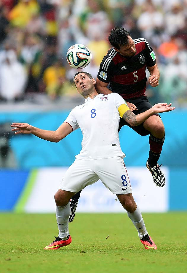 Clint Dempsey gets pulled back by Mats Hummels as he tries to head the ball. The United States reached the knockout stage of consecutive World Cups for the first time.