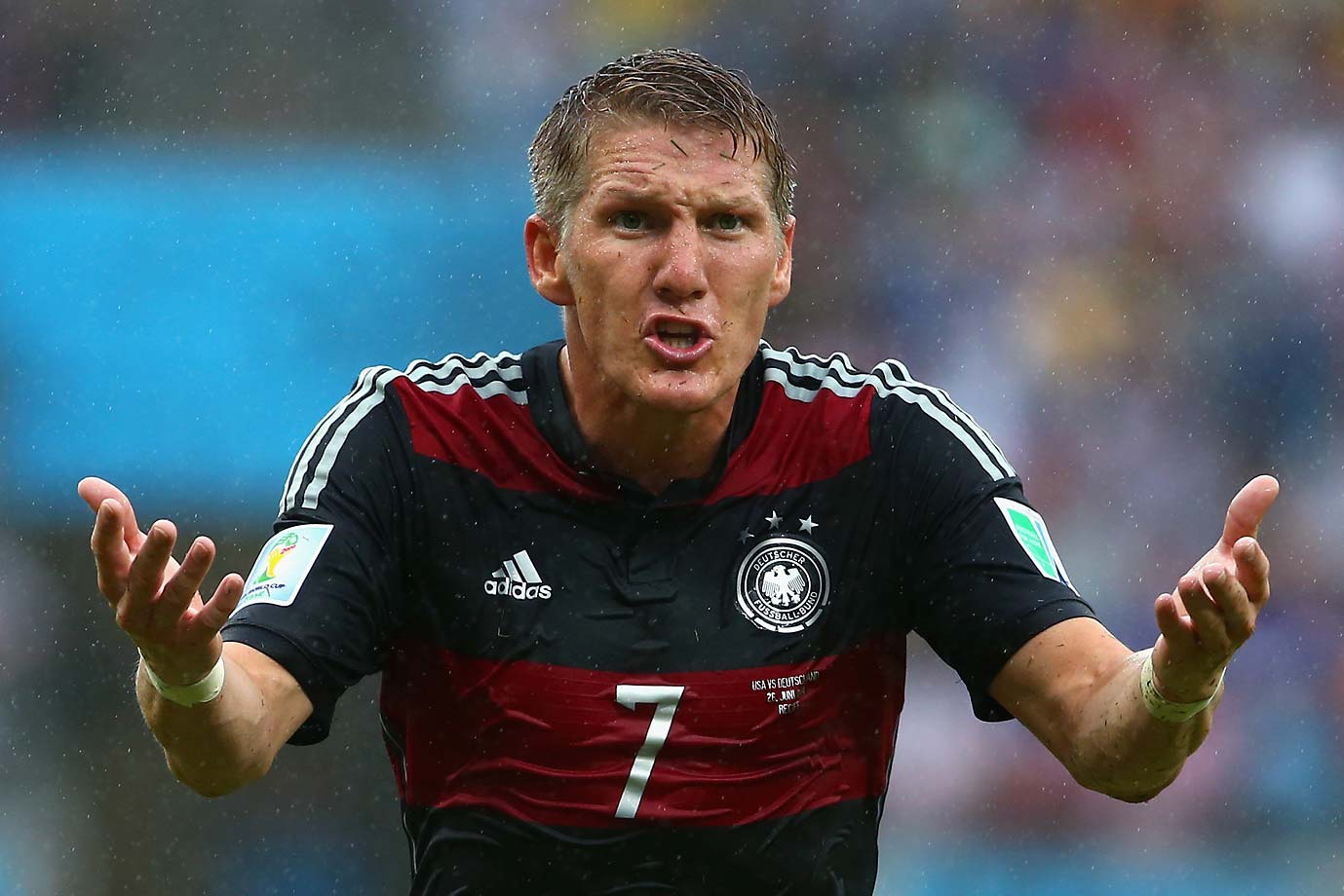 Bastian Schweinsteiger of Germany states his case while looking for a call to go his way.
