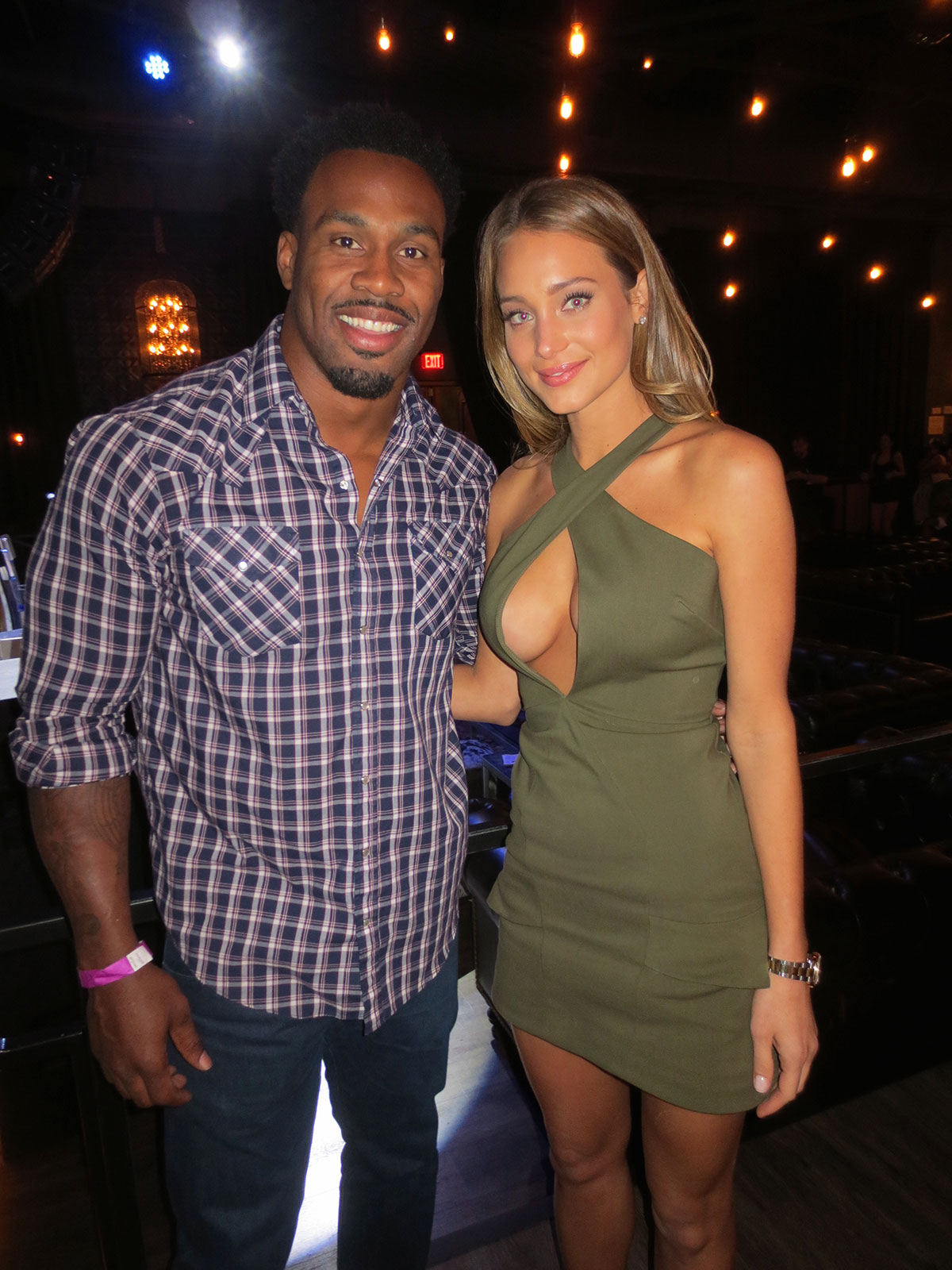 NFL player Steven Jackson and Hannah Davis attend SI's Draft Day Viewing Party at The Sayers Club at SLS Las Vegas Hotel & Casino.