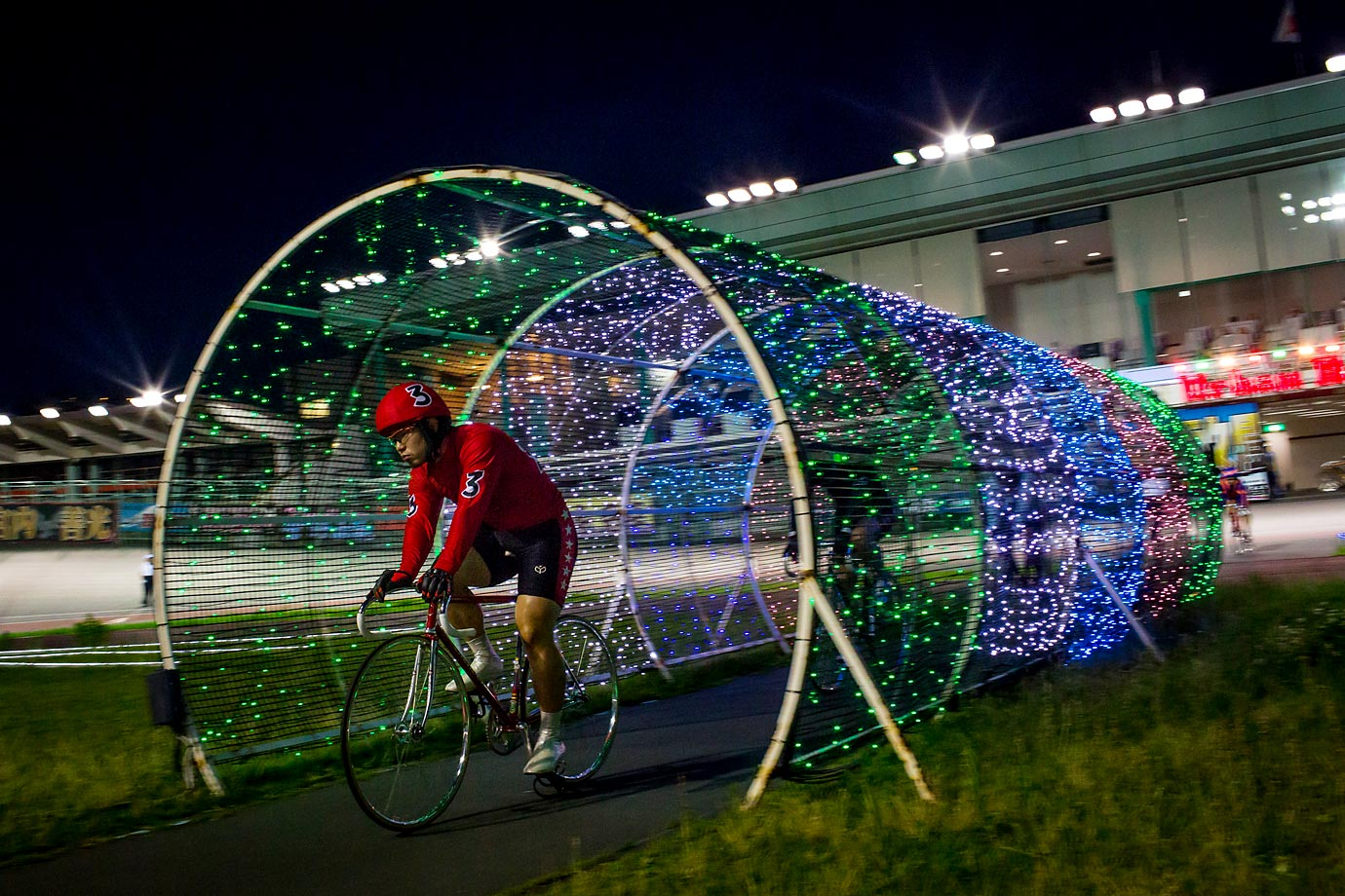 A cyclist enters the velodrome during Keirin races at Kawasaki Velodrome in Japan. Keirin is a form of racing developed in Japan around 1948 for gambling purposes, and has since become extremely popular.
