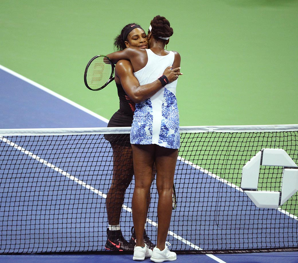 Serena Williams hugs Venus after winning their quarterfinal match at the U.S. Open on Sept. 8, 2015.