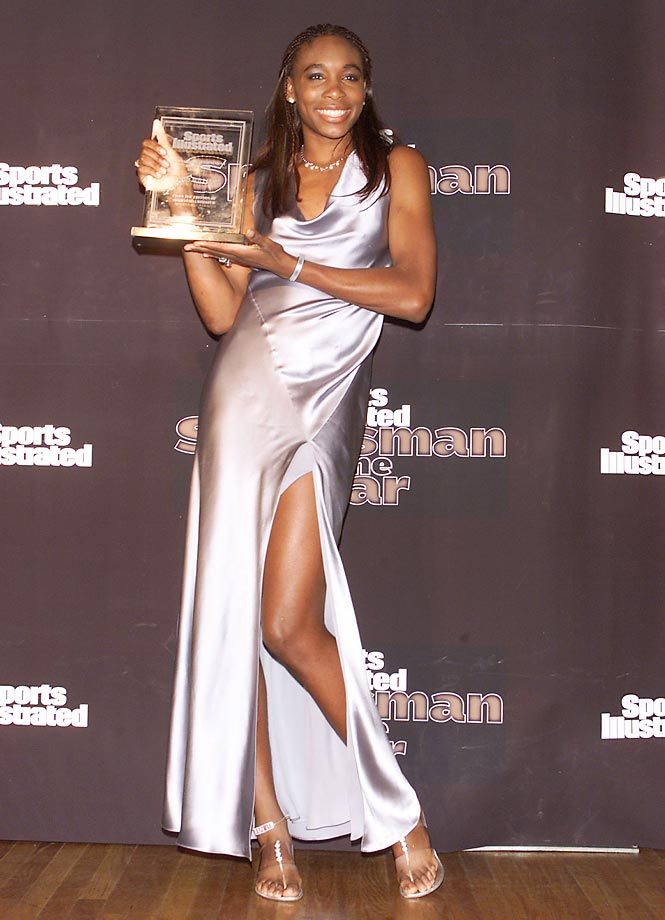 Williams holds up a trophy at Sport Illustrated's Sportsman of the Year celebration after winning the singles and doubles titles at Wimbledon, the singles title at the U.S. Open and two gold medals in singles and doubles play. She finished the year ranked No. 3 and at one point during the season had a 35 consecutive match win streak.