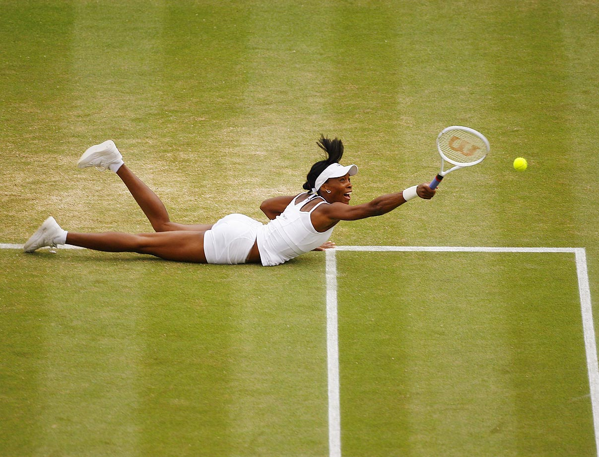 William lays out to return a point to Maria Sharapova in the fourth round at Wimbledon. Williams beat Sharapova 6-1, 6-3 to advance to the next round.