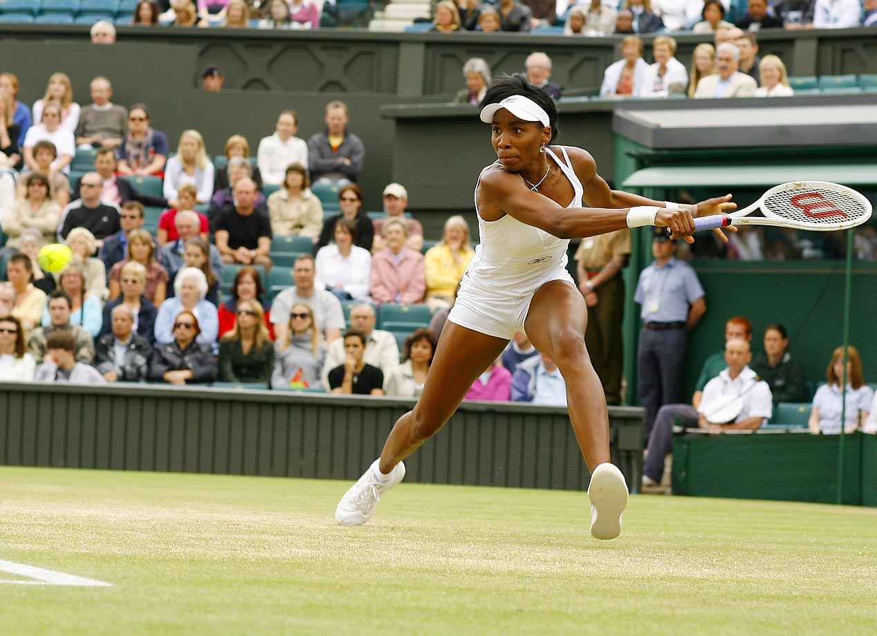 Williams returns a forehand to Svetlana Kuznetsova in a Wimbledon quarterfinal match, which Williams won 6-3, 6-4. Despite being a No. 23 seed, Williams would go on to capture the singles title for her sixth Grand Slam title and fourth win at the All England Club.