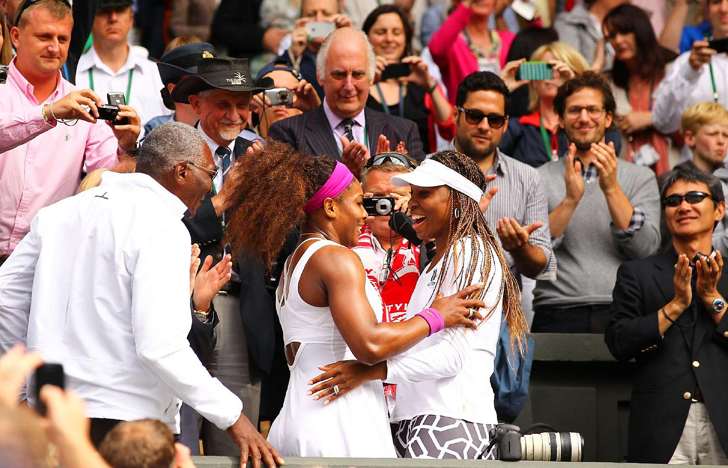 Despite the number of tough matches the two have played, Venus and Serena have always supported each other at matches, like here, when Venus watched her sister win her 14th Wimbledon title after Venus lost in the first round.