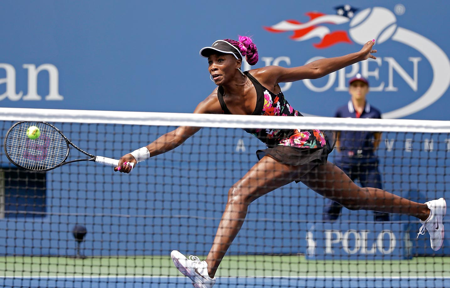 Williams returns a shot to 12th seed Kirsten Flipkens at the U.S. Open. Williams, who was still suffering from different injuries, pulled out the huge upset over Flipkens.