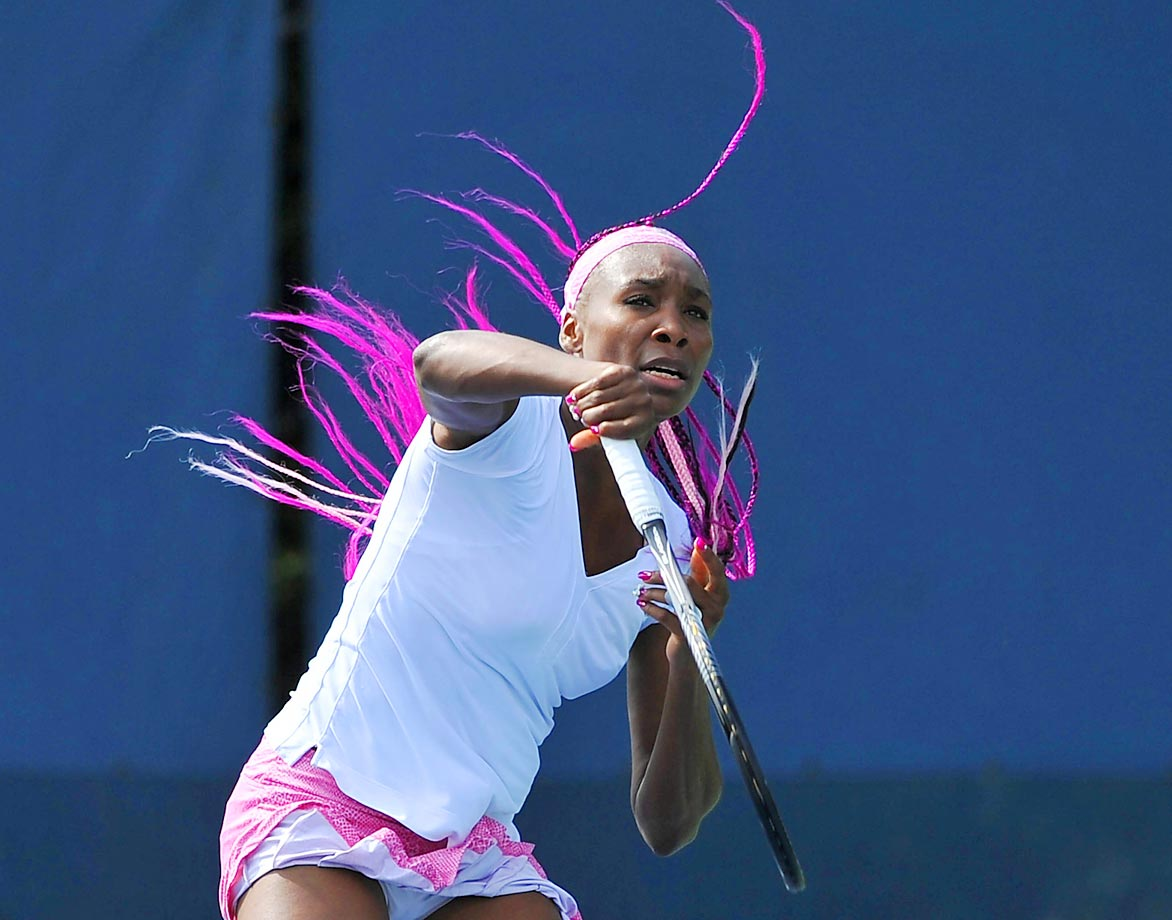 Williams' purple braids, which were on display during a practice round in 2013, caused a stir at the U.S. Open. In tournament play, she also debuted a number of other accessories, including rhinestones on her wrist, a small bow on her fourth fingernail and a giant ring on that same finger.
