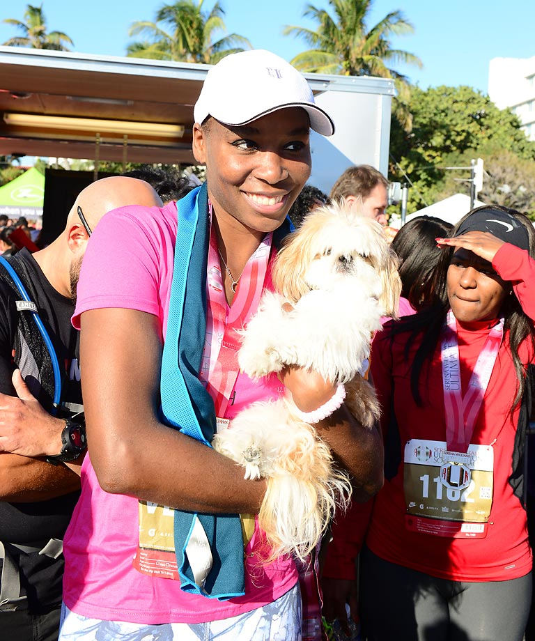 Williams, here participating in the Serena Williams Ultimate Run in Miami Beach, Fla., is a part-owner of the Miami Dolphins along with her sister. They became the first female African American owners in the NFL.