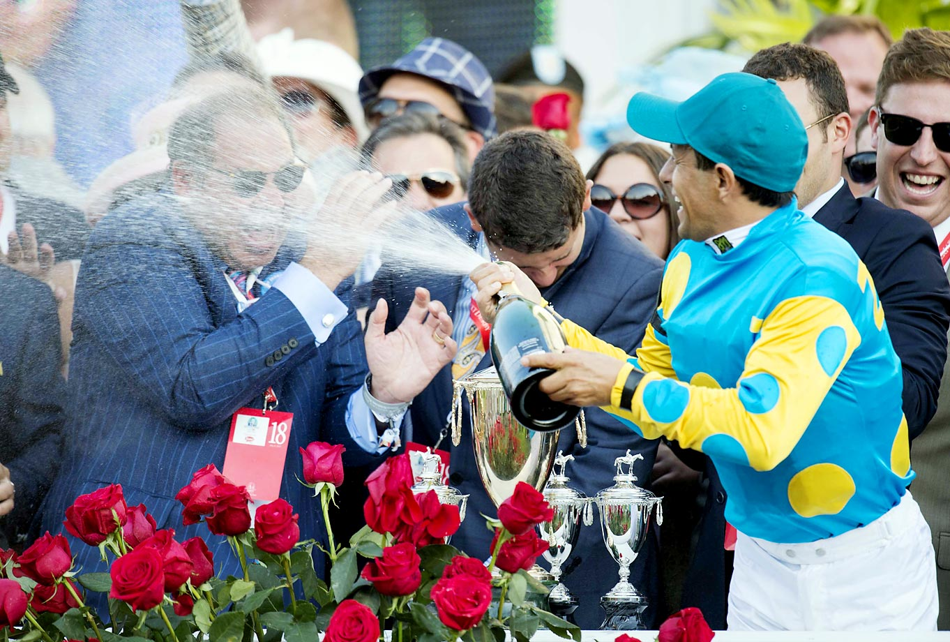 Winning jockey Victor Espinoza celebrates after the 141st running of the Kentucky Derby.