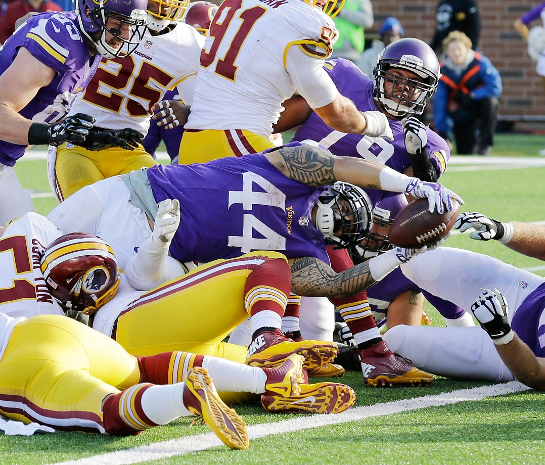 Vikings running back Matt Asiata dives in for a 1-yard touchdown in the fourth quarter against the Redskins.  Asiata scored three TDs in Minnesota's 29-26 win.
