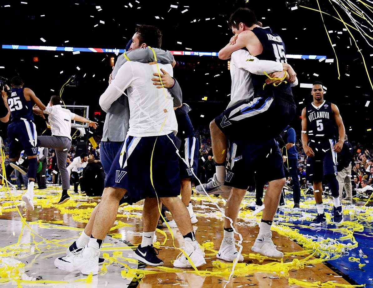 Villanova players celebrate the school's first national basketball title since 1985.