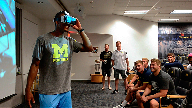 "The Real Feel: Kavanaugh created VR content that wowed the Michigan players (pictured). ""It's like you're right there,"" said one."