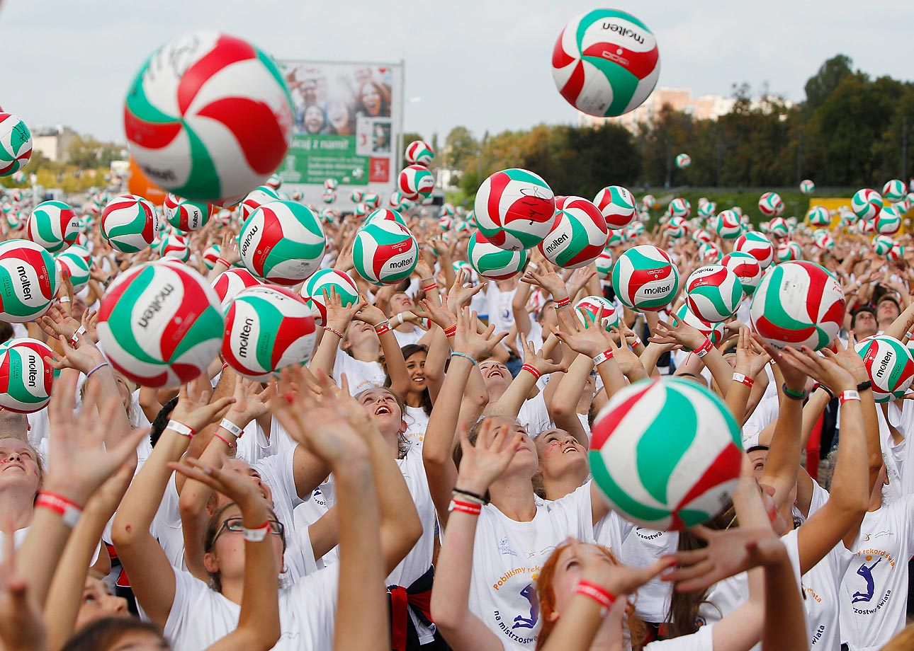 Hundreds of volleyball fans play with balls to beat a Guinness world record during an event in Warsaw, Poland.
