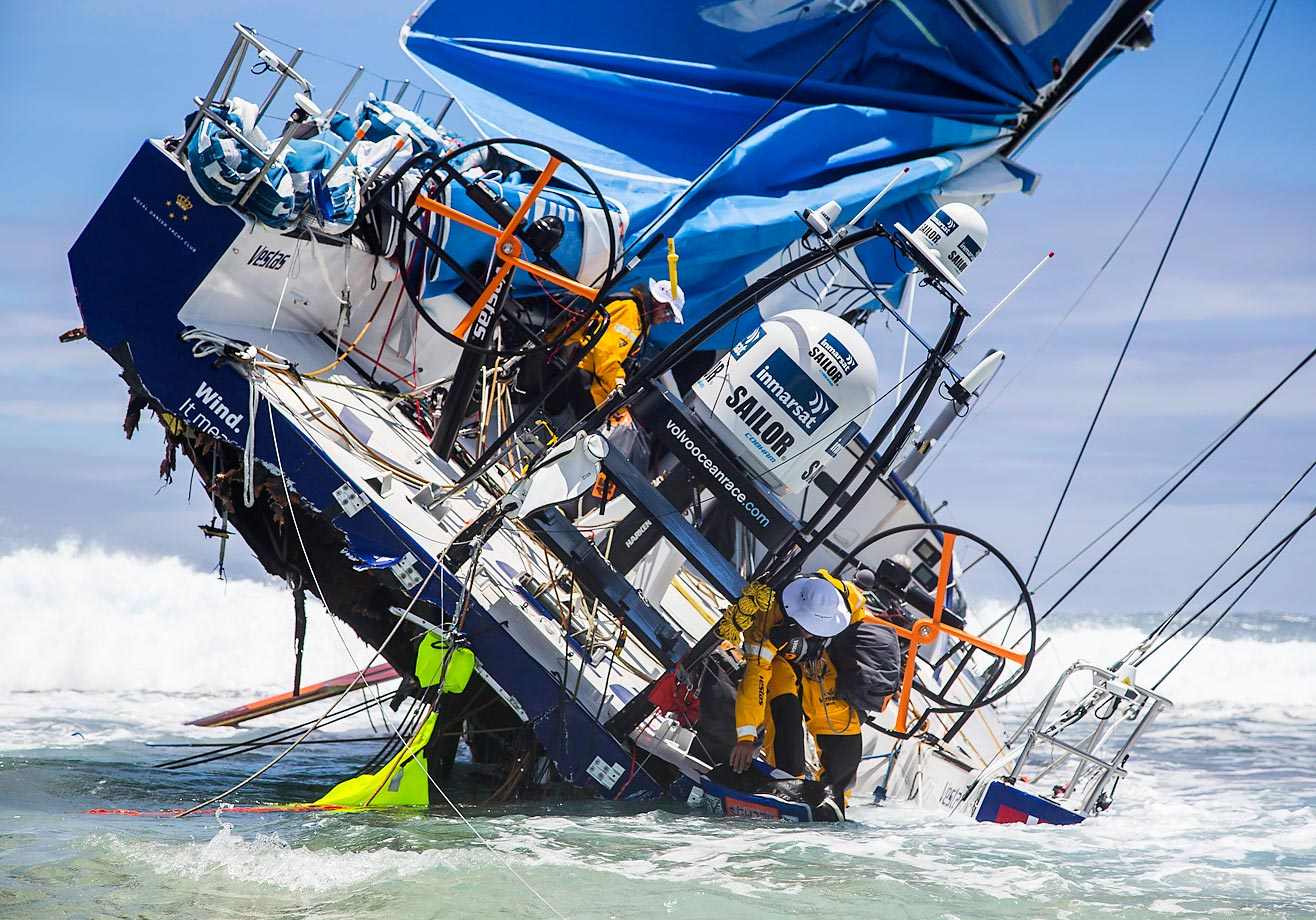 The crew of Team Vestas Wind heads back to the boat to retrieve everything it can following the grounding of its boat on a reef at the Volvo Ocean Race 2014-15.