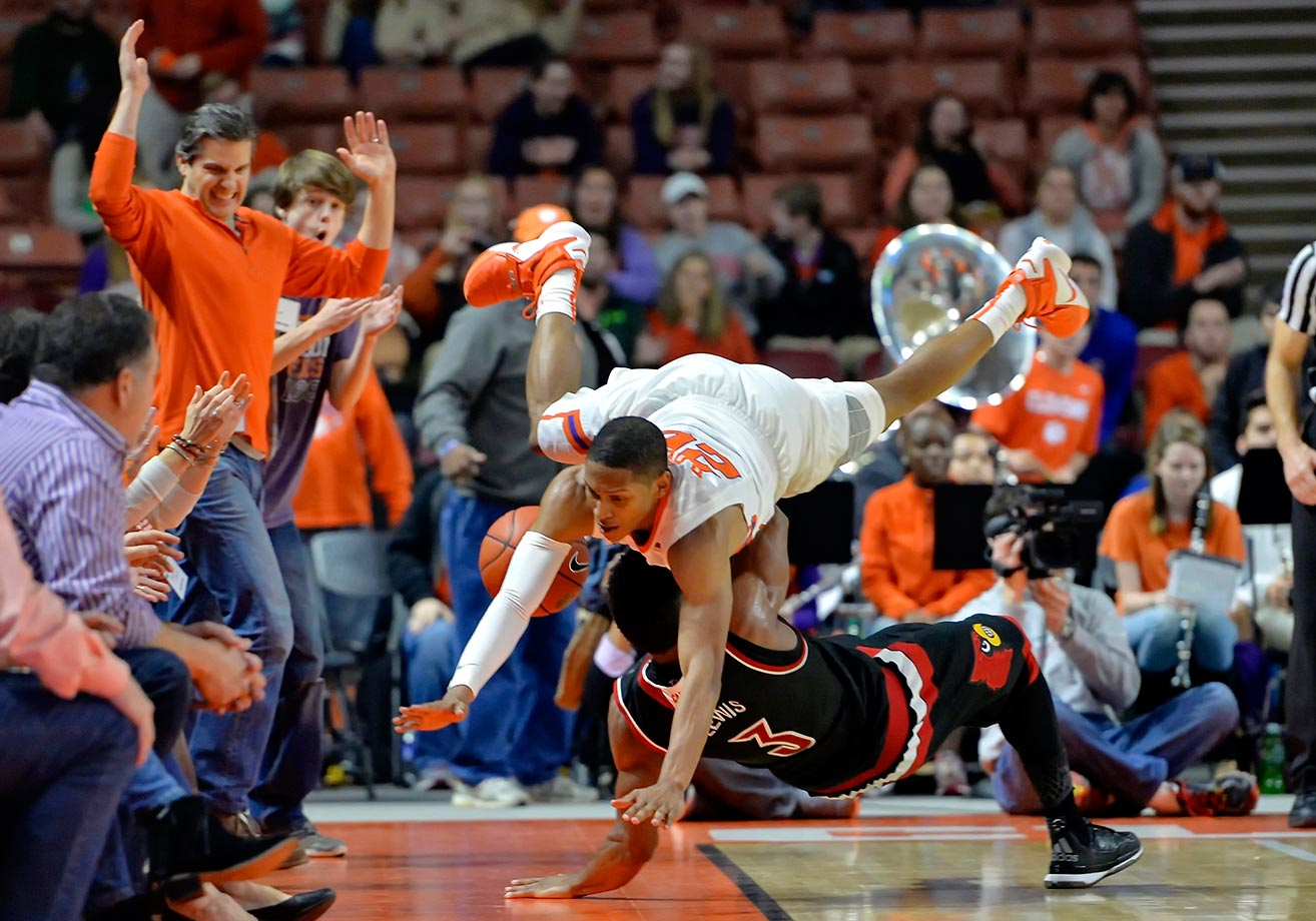 Jordan Roper of Clemson collides with Trey Lewis of Louisville.