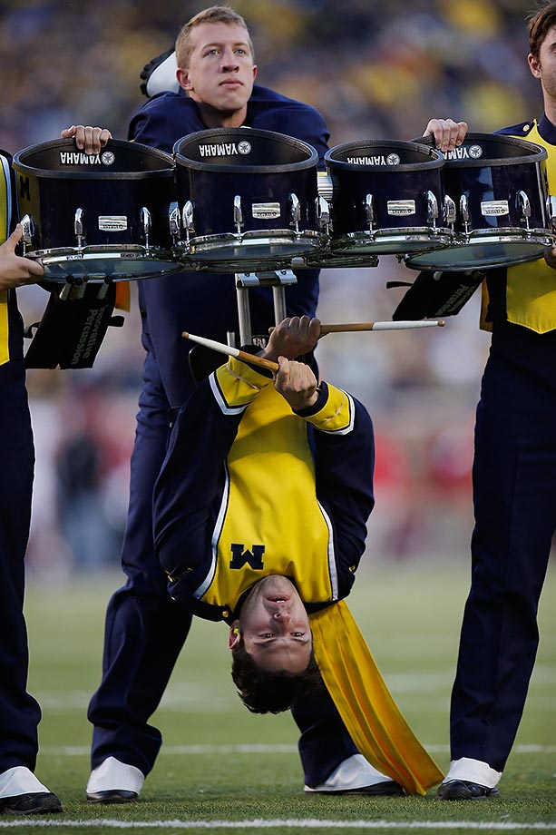 Members of the Michigan drum line perform at a game against Rutgers.