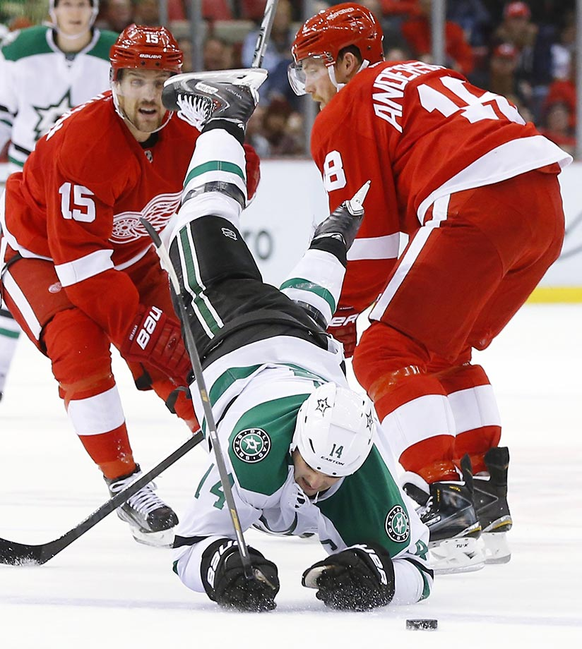 Jamie Benn of the Dallas Stars is checked by Joakim Andersson of the Detroit Red Wings.