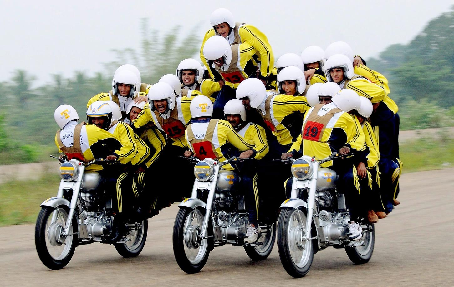 The Tornadoes, members of the Motor display team from Army Service Corps in India, attempt to set a World record for fastest moving human pyramid. The Tornadoes set the record with 32 men on three 500cc motorcycles covering a distance of 1Km.